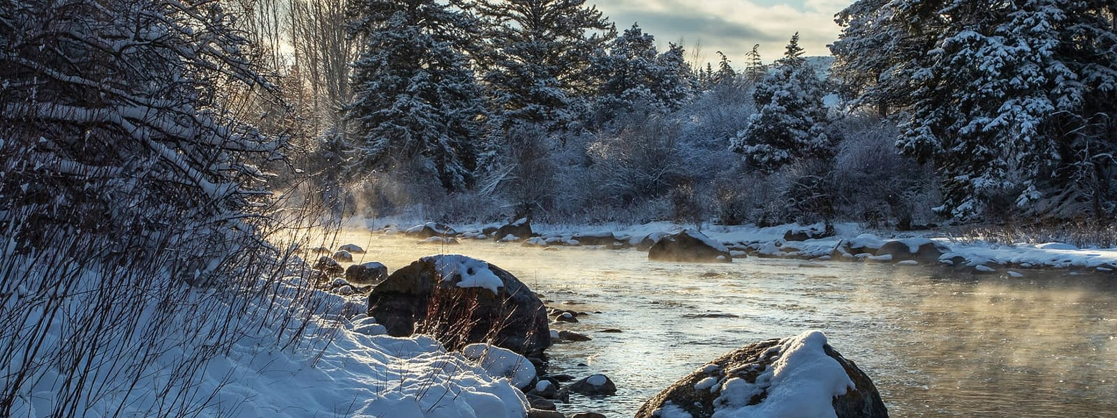 Steaming Eagle River Image by Eagle Valley Wild. Snowy Rocks and trees. Eagle County, Colorado