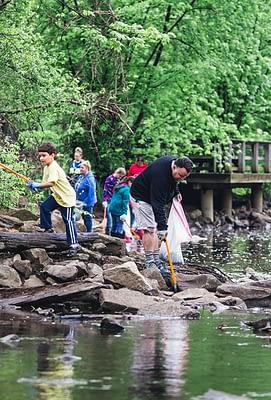 Picking up trash. Cleanup. Volunteer. Children. Stewardship. Conservation